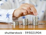close up of girl hand putting... | Shutterstock . vector #595021904