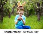 happy little toddler boy eating ... | Shutterstock . vector #595031789