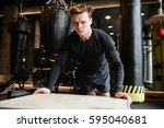 athletic man which push ups on... | Shutterstock . vector #595040681