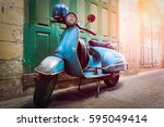 Stock photo vintage scooter stands in an alley post process in vintage styl 595049414