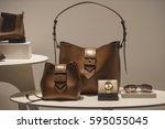 luxury handbags in a store... | Shutterstock . vector #595055045