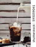 coffee drink. ice latte with... | Shutterstock . vector #595059041