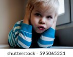 portrait of little two years... | Shutterstock . vector #595065221