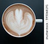 top view of a mug of latte art...   Shutterstock . vector #595068191