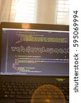 Small photo of Web development phrase ASCII art inside real HTML code. Web developing concept on screen. Abstract information technology modern background. Laptop in sunset lights. Code is created by myself.