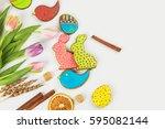 tulips and gingerbread cookies... | Shutterstock . vector #595082144