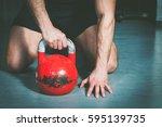 strong muscular man with... | Shutterstock . vector #595139735