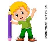 kids boy with big pencil cartoon | Shutterstock . vector #595141721