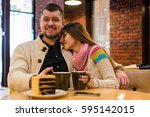 lovely couple sitting in a...   Shutterstock . vector #595142015