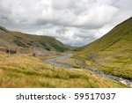 Cwmystwyth hills in Ceredigion Wales and ruins of the old lead mine. - stock photo