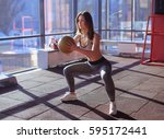 woman doing squat with medicine ... | Shutterstock . vector #595172441