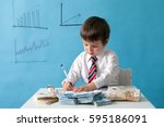young boy  counting money and... | Shutterstock . vector #595186091