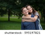 mother and adult daughter... | Shutterstock . vector #595197821