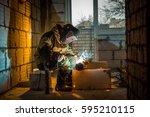 welder working welding  the... | Shutterstock . vector #595210115