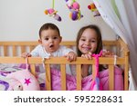 two sisters in bed at night  ... | Shutterstock . vector #595228631