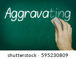 Small photo of Hand erasing the word AGGRAVATING written on blackboard