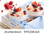 oatmeal with fresh fruits and... | Shutterstock . vector #595238165