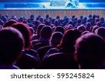 people in the auditorium... | Shutterstock . vector #595245824