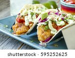 close up of plate of fish tacos ... | Shutterstock . vector #595252625