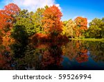 Colorful Autumn Trees Reflecte...