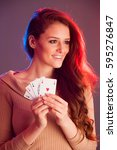 beautiful brunette holding four ... | Shutterstock . vector #595276847