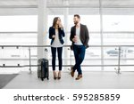 business couple standing... | Shutterstock . vector #595285859