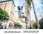 parkour man doing tricks on the ... | Shutterstock . vector #595293929
