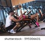 personal fitness instructor... | Shutterstock . vector #595306631