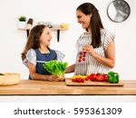 shot of a mother and daughter... | Shutterstock . vector #595361309