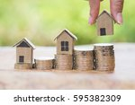 woman's hand putting house...   Shutterstock . vector #595382309