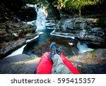 hiker on red sleeping bag in... | Shutterstock . vector #595415357
