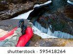 hiker on a sleeping bag in... | Shutterstock . vector #595418264