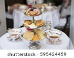 tea party with sandwiches | Shutterstock . vector #595424459