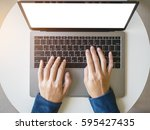 Woman Hand Type On Laptop...