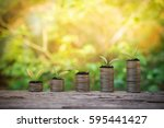 plants growing up on stack of... | Shutterstock . vector #595441427