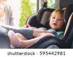 toddler girl buckled into her... | Shutterstock . vector #595442981