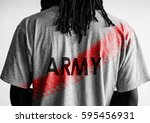 back of man wearing army t... | Shutterstock . vector #595456931