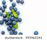 blueberries isolated on white... | Shutterstock . vector #595462241
