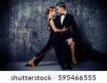 beautiful passionate dancers... | Shutterstock . vector #595466555