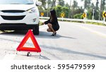 Small photo of photo of businesswoman with flat tire