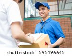 woman hand accepting a delivery ... | Shutterstock . vector #595496645