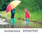 children walking in wellies in... | Shutterstock . vector #595507559