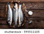 fresh raw sea bass fish on... | Shutterstock . vector #595511105