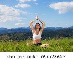 beautiful young girl doing yoga ... | Shutterstock . vector #595523657