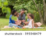 cheerful family sitting on the... | Shutterstock . vector #595548479