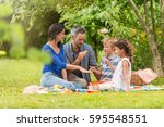 cheerful family sitting on the... | Shutterstock . vector #595548551