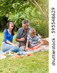 cheerful family sitting on the... | Shutterstock . vector #595548629