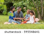 cheerful family sitting on the...   Shutterstock . vector #595548641