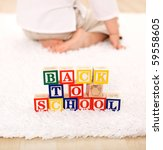 Child turning away from toy blocks - back to school concept - stock photo