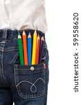 Colored pencils in child back pocket - isolated, closeup - stock photo